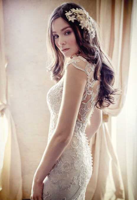 Model wearing white Magiie Sottero dress